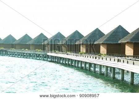 Water villas over ocean background, in resort