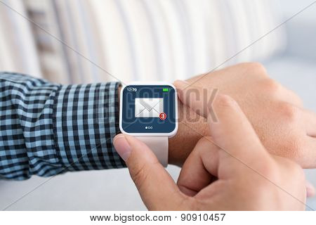 Male Hands With White Smartwatch And Email On The Screen