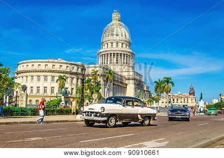 HAVANA, CUBA - DECEMBER 2, 2013: Old classic American car rides in front of the Capitol. Before a ne