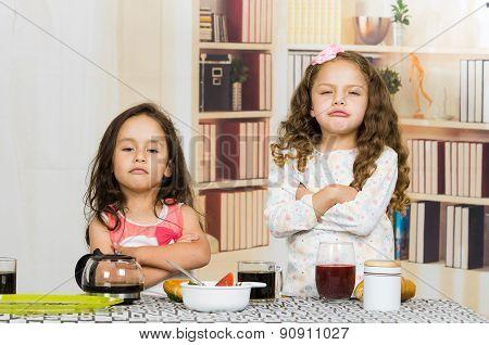 Two young preschooler girls refusing to eat