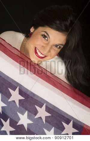 Attractive Woman Looking Over The American Stars And Stripes