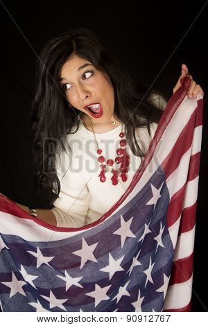 Pretty Woman With An Open Mouth Expression Holding American Flag