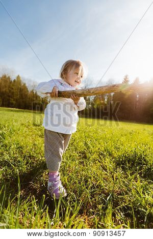 Little girl with a stick