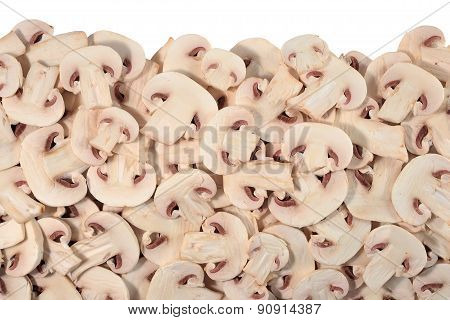 Heap Of Sliced Mushrooms On A White