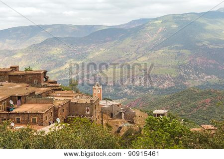 TADDERT, MOROCCO, APRIL 15, 2015: View of High Atlas mountains and traditional buildings in region of Tizi n'Tichka mountain pass
