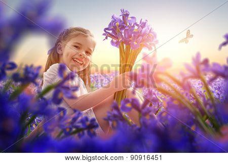little girl and purple iris