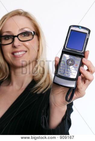 Famale Holding An Open Flip Phone