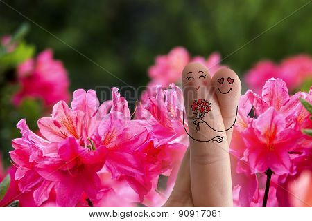 Conceptual Family Finger Art. Lovers Are Embracing And Holding Bouquet Of Red Flowers.