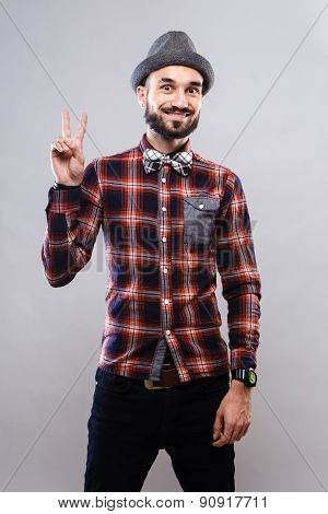 Charismatic guy in glasses and plaid shirt