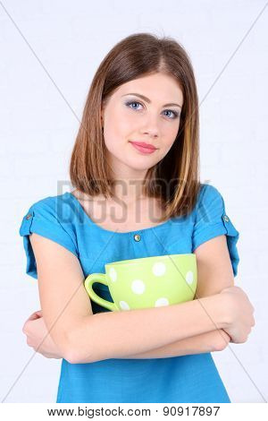 Beautiful girl with large cup