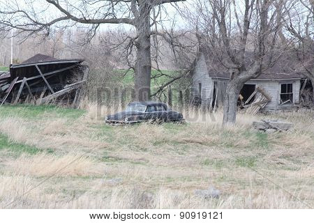 Abandoned Property with Car and Buildings