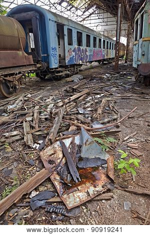 Abandoned train carriage in a decaying depo