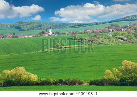 Little town on the hills, blue sky, beautiful buildings and nature, traditional architecture, summer vacation concept, Europe, Czech Republic