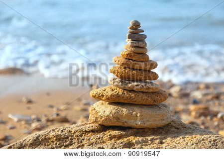 Stones balance and blue sea on defocused background with bokeh. Spa, freedom and stability concept on rocks