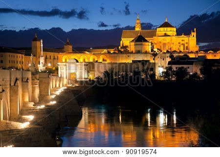 Cityscape of Cordoba at night with Roman bridge and Mezquita - beatiful lights, Andalusia, Spain, Europe