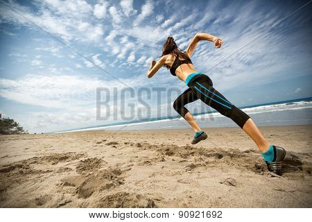 poster of  Running woman, female runner jogging during outdoor workout on beach., fitness model outdoors.