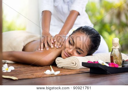 Woman in a day spa getting a deep tissue massage of back  therapy
