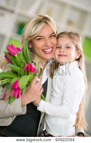 Happy mom with her daughter, lovely hug on mother's day