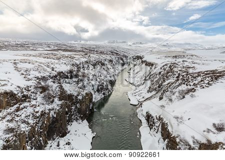 Winter landscape, river and cliff at northern Iceland