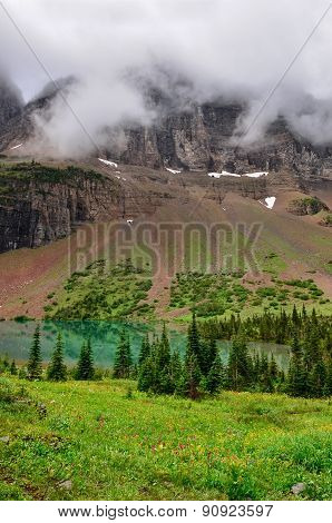Scenic View Of Alpine Meadow And Mountain Lake