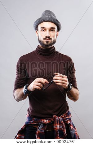 Charismatic guy in glasses and shirt belt