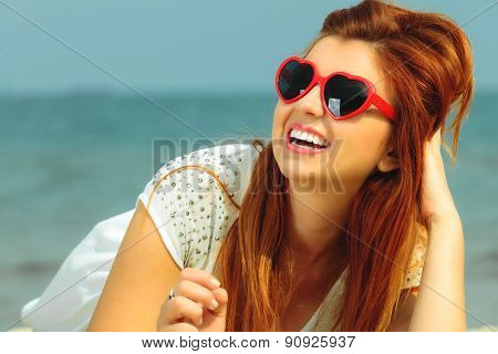 Beautiful Redhaired Girl In Sunglasses On Beach, Portrait