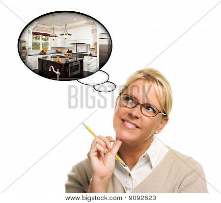 Woman With Thought Bubbles Of A New Kitchen Design