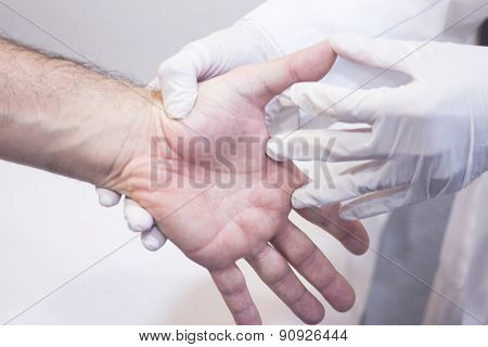 Dooctor Surgeon Examines Patient Hand Fingers Wrist Injury
