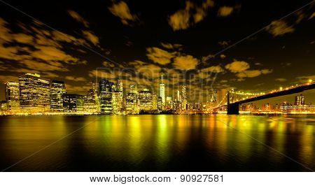 Brooklyn Bridge at night with Lower Manhattan background