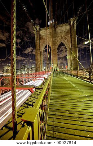Brooklyn Bridge at night with speeding traffic