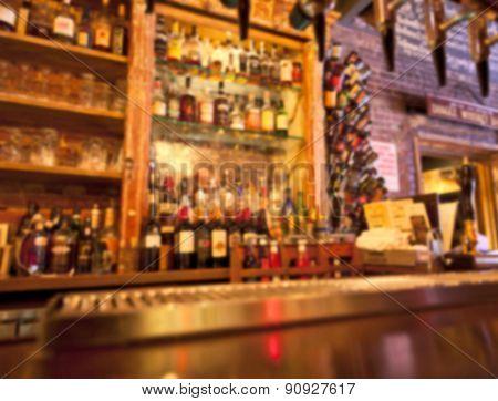 Unrecognizable bar counter and bottles background blurred filter