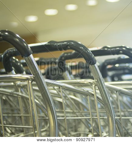 Luggage Trolleys In Rows In Airport Arrivals Lounge