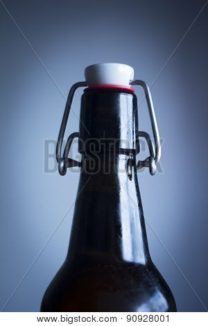 Lager Beer Bottle Studio Isolated Close-up Plain Blue Background