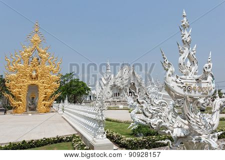 CHIANG RAI, THAILAND - APRIL 24, 2009: The Wat Rong Khun Temple, also known as the Silver Temple is designed by a famous Thai artist Chalermchai Kositpipat. This is an important tourist destination.