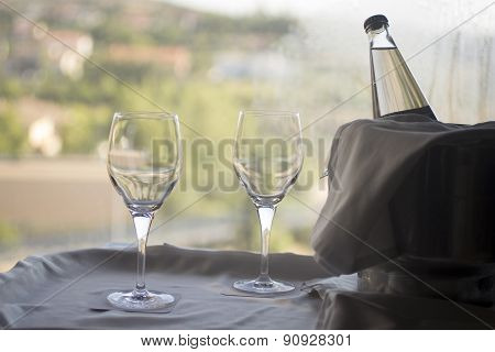 Glasses And Bottle Of Water In Metal Ice Bucket
