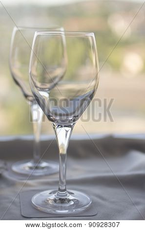 Wine Or Water Glasses On Coasters On Cloth On Tray