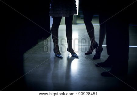 Feet Of Female Wedding Guest In High Heel Shoes In Party