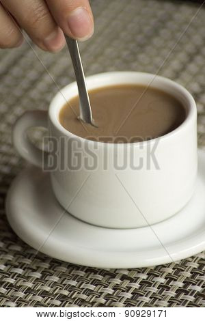 Hand Stirring Spoon In Cup Of Coffee Expresso