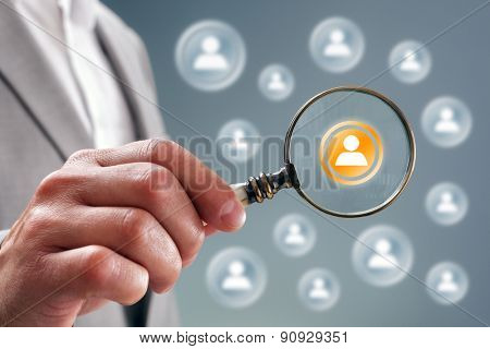 Businessman with magnifying glass on team personnel or contact icon concept for recruitment, social media, network, community and  internet marketing