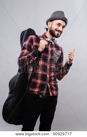 Charismatic musician in glasses and plaid shirt