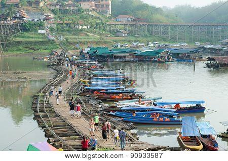 Traveler Crossing Wooden Bridge Or Mon Bridge In Sangklaburi