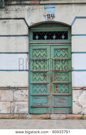 Ornate, Weathered Blue-green Door In Cuenca, Ecuador