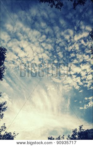 Retro styled photo of beautyful blue sky and clouds
