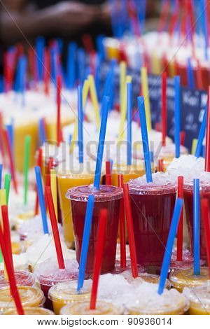 Fresh fruits juices and colorful drinking straw