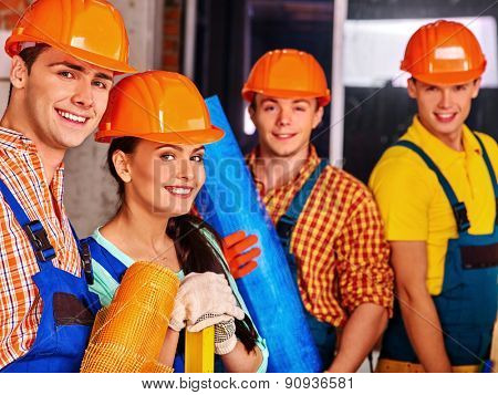 Happy group people in builder uniform. Four people.
