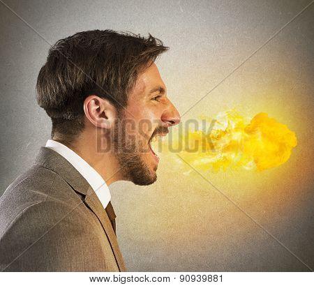 Businessman spits fire