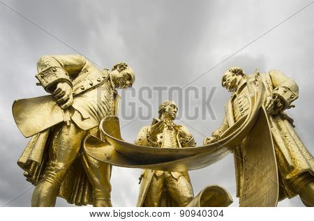 Birmingham, England.  May 17th 2015 The gilded bronze statue of Matthew Boulton, James Watt and William Murdoch Famous for developing the steam engine.