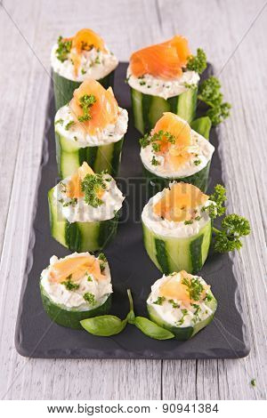 finger food with cucumber,cheese and salmon