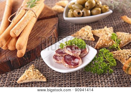 buffet food with olive,breadstick and salami