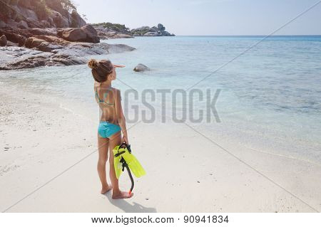 Preteen child are going snorkeling on a tropical beach